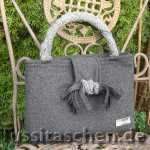 Handtasche aus grauer Woll-Kaschmir-Mischung mit Knotenschleife. Innenfutter magenta, Verkauft.